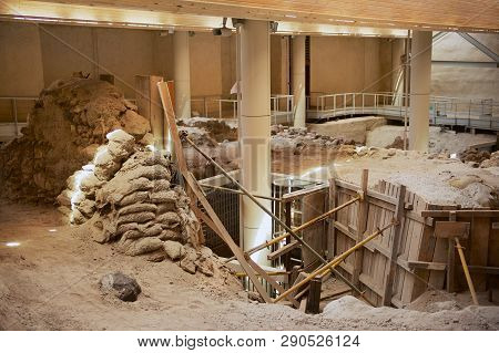 Akrotiri, Greece - August 01, 2012: Ruins Of The Ancient Buildings From The Minoan Bronze Age At The