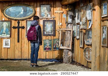 Klin, Slovakia - March 17: Boy Looking At Christian Images Near Statue Rio De Klin On March 17, 2019