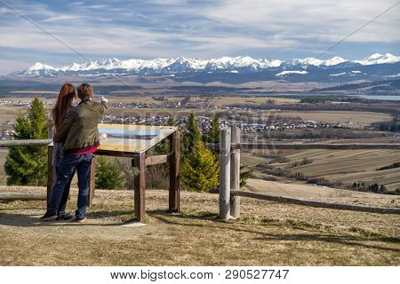 People Looking At High Tatras Mountains From Grapa Hill, Slovakia