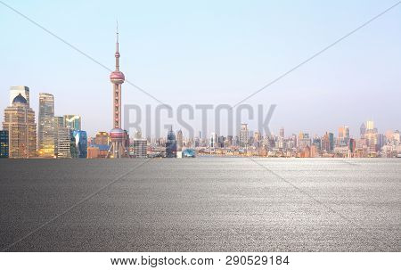 Empty Road Surface Floor With City Landmark Buildings Of Shanghai Skyline
