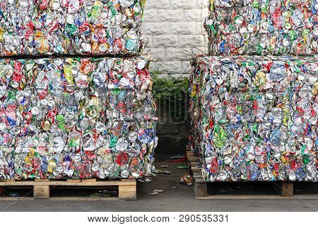 Blocks Pressed Aluminum Cans From Soft Drinks. Compacted Blocks Of Cans For Recycling At The Recycli