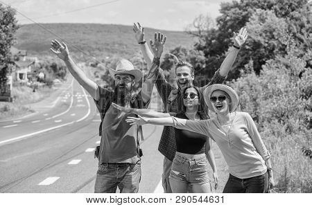 Travellers Try To Stop Car. Friends Hitchhikers Travelling Summer Sunny Day. Company Friends Travele