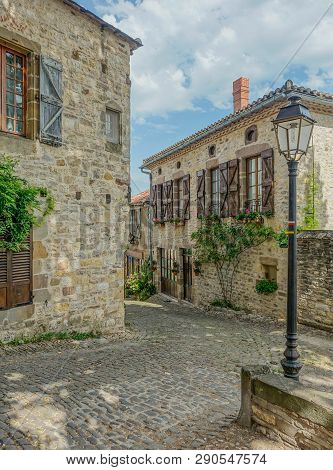 Cordes-sur-ciel, Midi Pyrenees, France - July 19, 2017: Typical Narrow Street Of The Village Cordes-