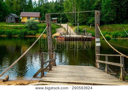 Ligatne Ferry Crossing On The Bank Of River Gauja. Ferry Across River In Latvia. The Ferry Over Gauj