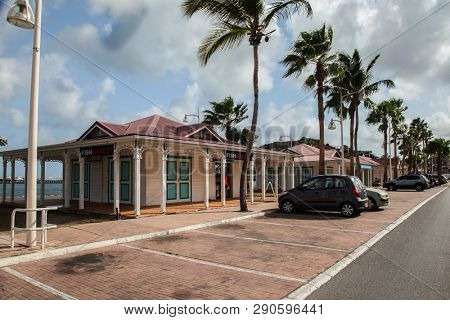 MARIGOT, SINT  MAARTEN - JULY 31, 2015: Fish market landmark area in Marigot with parking on front.