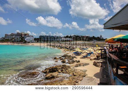 MAHO BAY BEACH, ST.MAARTEN  - AUGUST 01, 2015: Famous landmark Maho Bay Beach view from Sunset Bar and Grill near Princess Juliana International Airport