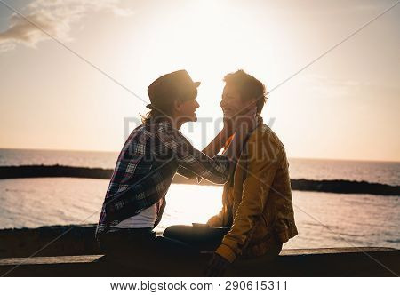 Happy Gay Couple Dating Next The Beach At Sunset - Young Lesbian Women Having A Tender Romantic Mome