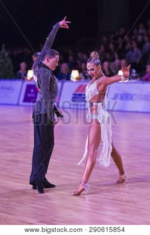 Riga, Latvia-december 15, 2018: Professional Adult Dance Couple Performs Youth Latin-american Progra