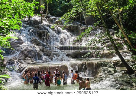 Ocho Rios, Jamaica - November 15, 2016: The Dunns River Falls Are Waterfalls In Ocho Rios In Jamaica