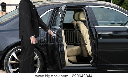 Chauffeur Opening Luxury Car Door For Vips