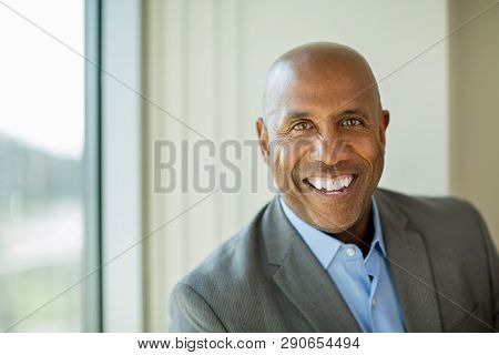 Happy Mature African American Man At Work.
