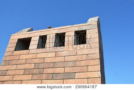 Incomplete house roof brick chimney construction photo poster