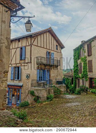 Cordes Sur Ciel, Midi Pyrenees, France - July 19, 2017: Typical Narrow Street Of The Village Cordes-