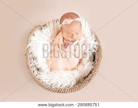cute sleepy newborn baby girl