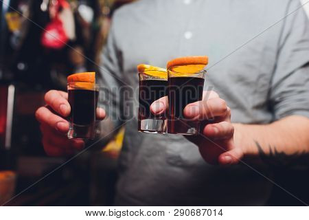 Jagermeister Shots Cocktails With Orange Hand Male.