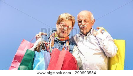 Senior Couple Shopping Together With Wife Watching In Husband Bags - Elderly Concept With Mature Man