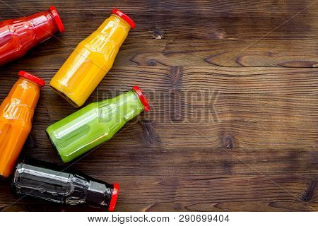 Healthy Organic Juice In Bottles For Fitness Diet And Detox On Wooden Background Top View Mockup
