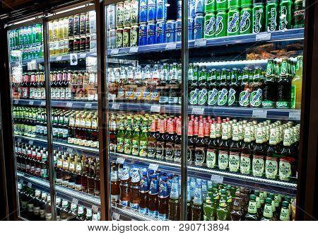 Minsk, Belarus, March 21, 2019: Many Bottles Of Beer Of Different Brands Show On A Shelf For Sale In