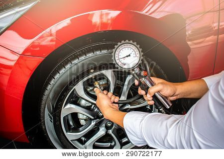 Asian Man Car Inspection Measure Quantity Inflated Rubber Tires Car.close Up Hand Holding Machine In