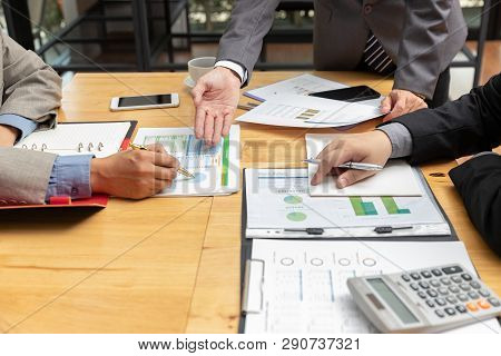 Business And Finance Concept Of Office Working, Businessman Using Smartphone And Discussing Investme