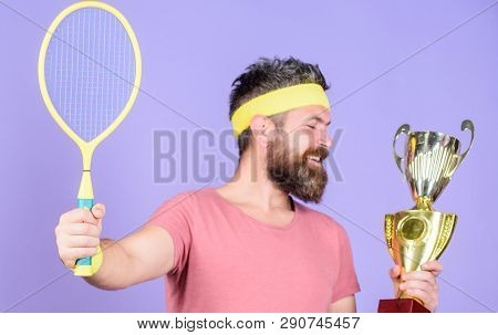 Tennis Player Win Championship. Athlete Hold Tennis Racket And Golden Goblet. Win Tennis Game. Man B