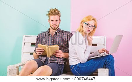 Couple Students With Book And Laptop Studying. Modern Students Use Digital Approach As Well As Class