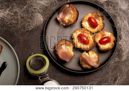 Several Puff Pastry Cups Stuffed By Cheese With Tomatoes And Ham