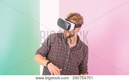 Man Unshaven Guy With Vr Glasses, Pink Background. Enjoy Virtual Reality. Hipster Use Modern Technol