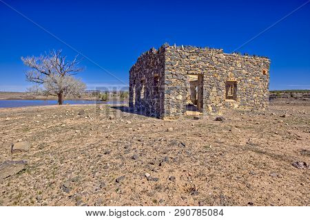 Ghost of Sullivan Lake in Paulden AZ. The ruins of a stone club house built in the 1930s as part of a WPA Project intended to create an artificial lake called Sullivan Lake. The project was abandoned when World War 2 broke out. poster