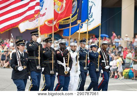 Indianapolis, Indiana, Usa - May 26, 2018,  Members Of The Us Military Carrying The American Flag Ma