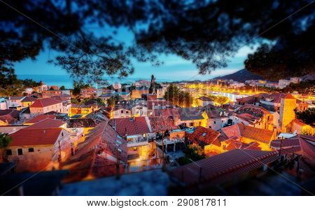 Fantastic evening view on old croatian town Omis. Location place Croatia, Dalmatia region, Balkans, Europe. Scenic image of european tourist resort. Tilt shift effect. Discover the beauty of earth.