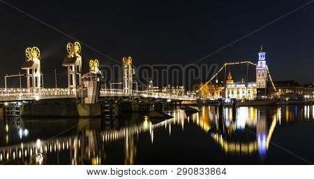 Kampen, Netherlands - February 27, 2019: City Bridge  At The Monumental City Of Kampen At The River