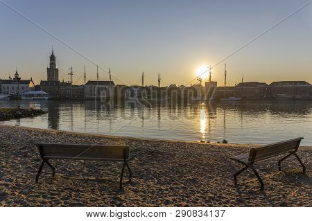Kampen, Netherlands - February 27, 2019: The Monumental City Of Kampen At The River Ijssel With Some