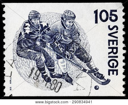 Luga, Russia - February 17, 2019: A Stamp Printed By Sweden Shows Two Bandy Players, Circa 1979