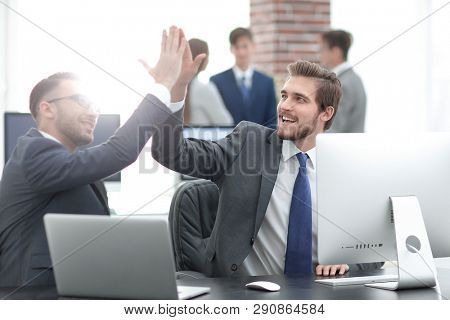 Successfull business people giving High Five for motivation
