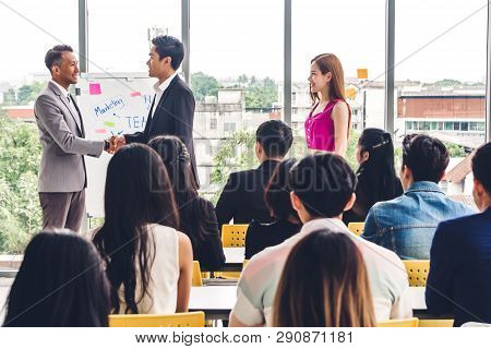 Businessman Standing In Front Of Group Of People In Consulting Meeting Conference Seminar.two Busine