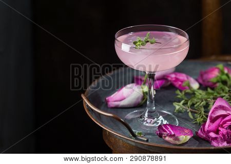Summer Refreshment Drinks. Light Pink Rose Cocktail, With Rose Wine On Dark Background. With Rose Fl