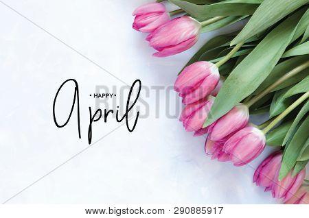 Inscription Happy April. Tulip Flower. Spring Background.