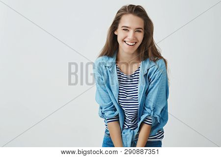 Smiling Attractive Happy Young Girl Laughing Carefree Having Fun Grinning Joyfully Bending Forward C