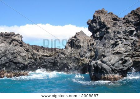 A lava arch formation on the coast of Maui Hawaii. poster