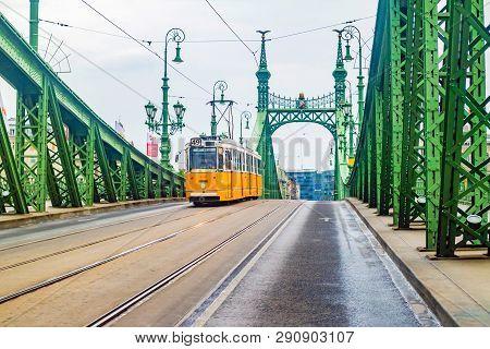 Budapest, Hungary - June, 2017: Liberty Bridge Or Freedom Bridge And Yellow Tram In Budapest, Hungar