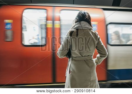 London, Uk - March 16, 2019: Rear View Of A Woman Standing On A London Underground Station Platform,