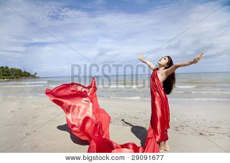 Woman In Red Scarf On The Beach