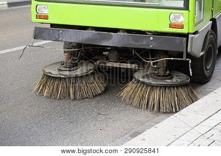 Street sweeper machine working. Street cleaning machine. poster