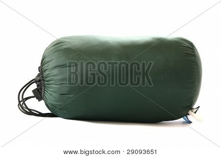 Packed sleeping-bag on white background
