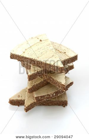 Stack of wafers in triangle shape with chocolat filling on white background