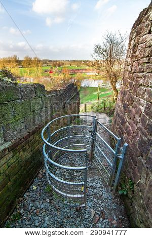 A Metal Gate Stands At The Entrance To A Public Park On The River Severn In Shrewsbury, Shropshire,