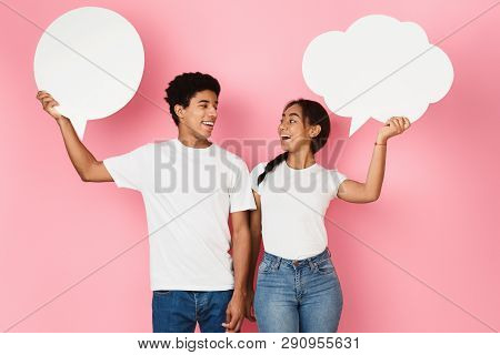 Teen Couple With Blank Speech Bubbles On Pink Background