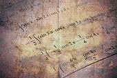 Detail of math textbook and an example of differential and integral calculus poster