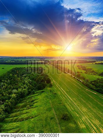 Rural Summer Sunset Landscape With Green Fields And Dramatic Colorful Sky, Natural Background, Aeria
